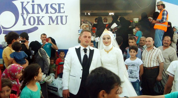 Bride and Groom Feed Refugees on Wedding Day