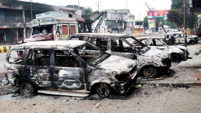 Communal riots, cars burnt