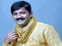 Gold shirt man