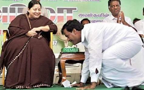 minister at feet of jaya, as she laughs