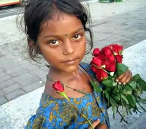 Girl selling Roses