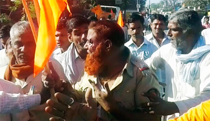 Policeman beaten up by RSS