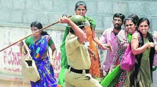 Indian policeman beating civilians