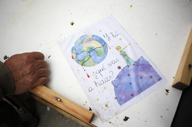 "A drawing of the cover of the book ""The little Prince"" by Antoine de Saint-Exupery bears the sentence ""And you. What are you going to do?"" on a stand at Madrid's Puerta del Sol encampment June 6, 2011. Spaniards protesting over the handling of the country's economic crisis continue to keep their tents in central city squares this week, as a wave of similar protests spread to other major European cities.     REUTERS/Susana Vera (SPAIN - Tags: CIVIL UNREST SOCIETY ELECTIONS POLITICS)"