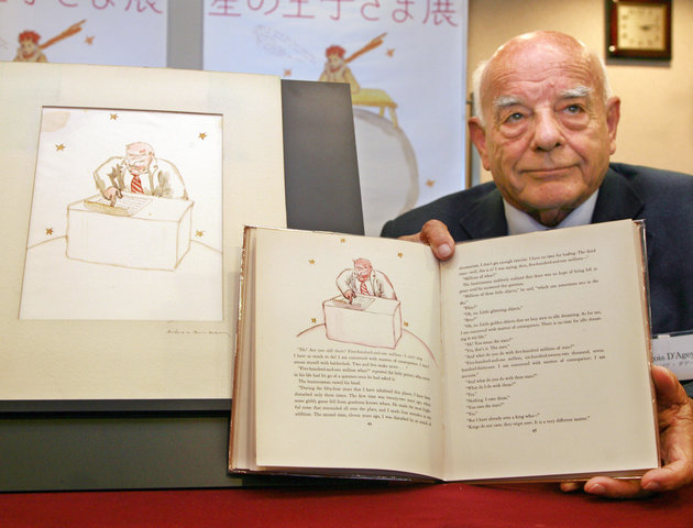 "Tokyo, JAPAN: Francois D'Agey, nephew of late French author Antoine de Saint -Exupery displays a book of ""The Little Prince"" as an original illustration of the book was discovered in Japan at a press conference in Tokyo 04 April 2007. A museum curator first bought the drawing in a secondhand book fair in 1994 but only recently realized that it belonged to the book's first edition issued in 1943 in the US.    AFP PHOTO / Yoshikazu TSUNO (Photo credit should read YOSHIKAZU TSUNO/AFP/Getty Images)"