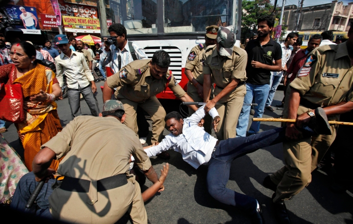 Indian police officers detain a member of a left-wing party during a protest in support of a general strike in Hyderabad, India, Tuesday, Feb. 28, 2012. Shops and banks were closed, factories shuttered and traffic sparse in major cities across India during an industrial strike Tuesday called by trade unions against the government. Eleven major trade unions called for the strike to protest against rampant inflation. (AP Photo/Mahesh Kumar A.)